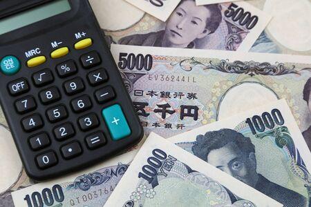Calculator on Japanese Yen banknotes