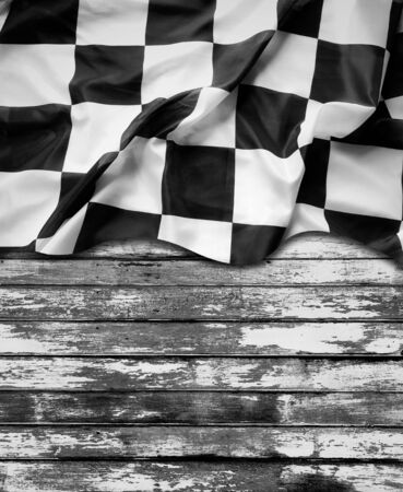 Racing flag and wooden boards Imagens