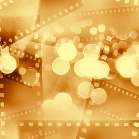 Film frames and lights brown background