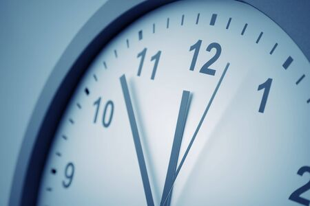Close-up of hands on clock face Imagens