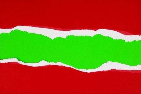 Hole ripped in red paper on green background. Christmas. Copy space 写真素材 - 131816236