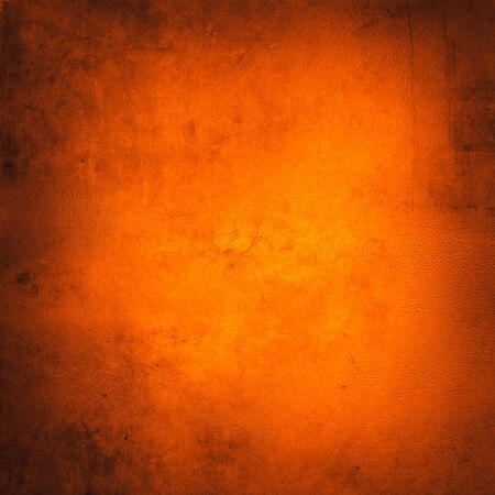 Orange color textured wall background
