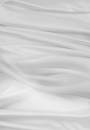 Closeup of rippled white silk fabric lines 写真素材 - 132090636