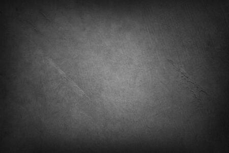 Fond texturé gris. Bords sombres. Espace de copie