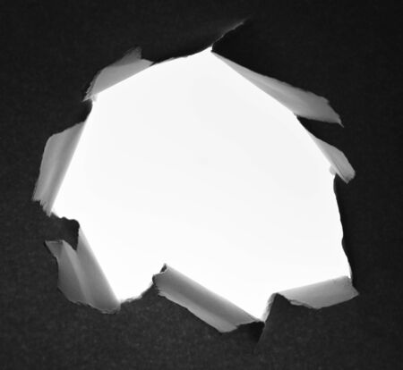 Hole ripped in paper background 写真素材 - 132090789
