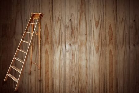 Ladder in front of wooden boards background 写真素材 - 132091590