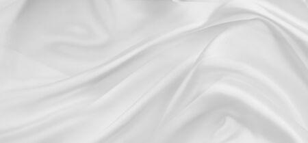 Closeup of rippled white silk fabric lines 写真素材 - 131258398