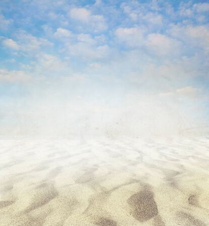 Light sandy beach and clouds background. Copy space