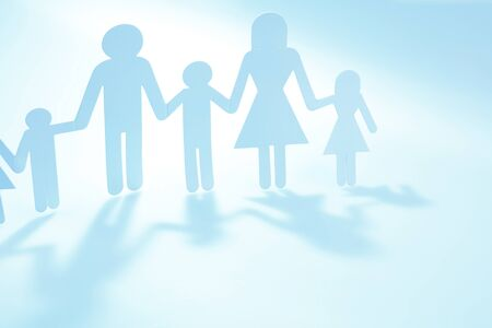 Family paper chain cutout holding hands 写真素材