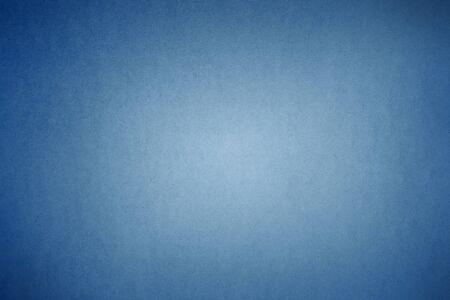 Blue textured gradient background. Dark edges