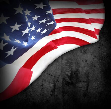 Close-up of American flag on dark grunge background 写真素材