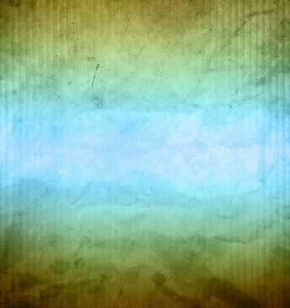 Close-up of blue and green grunge textured paper background