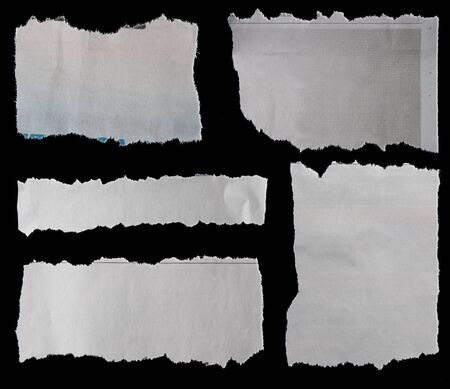 Five pieces of torn newspaper on black background 写真素材