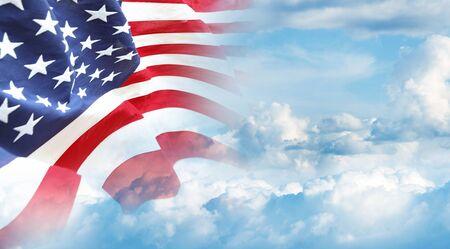 American flag in blue sky 写真素材