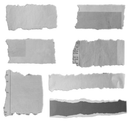 Seven pieces of torn paper on plain background