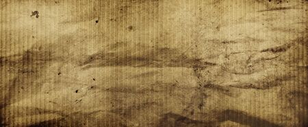 Close-up of brown grunge textured paper background
