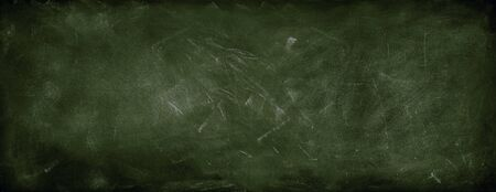 Chalk rubbed out on green chalkboard background Stock Photo