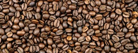 Closeup of roasted coffee beans 스톡 콘텐츠