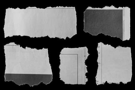 Five pieces of torn newspaper on black background