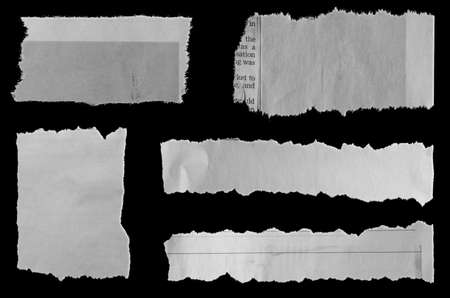 Five pieces of torn newspaper on black background 版權商用圖片