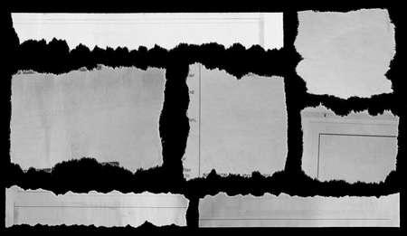 Seven pieces of torn newspaper on black background 版權商用圖片