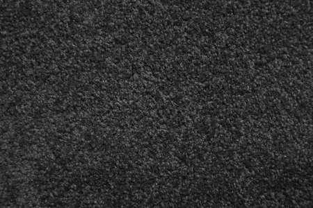 Short fiber black carpet close-up