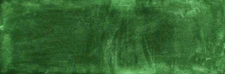 Chalk rubbed out on green chalkboard