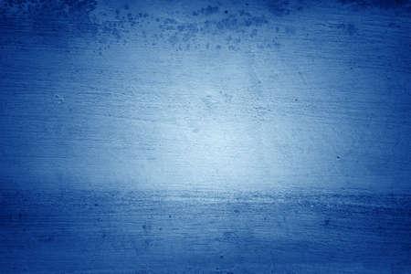 Close-up of blue textured concrete background. Dark edges