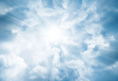 Bright rays shining in clouds Stock Photo