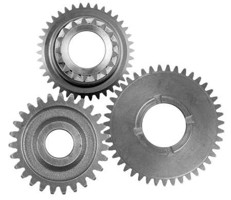 Three metal gears on plain background