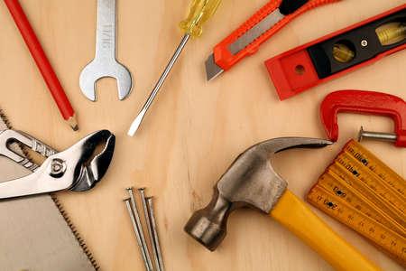 Assorted work tools on wood Foto de archivo
