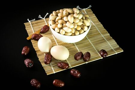 chinese herbs: Close up to chinese herbs on a bamboo mat Stock Photo