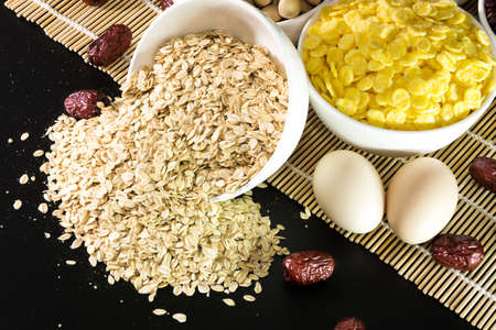 chinese herbs: Close up to chinese herbs and oat on a bamboo mat Stock Photo