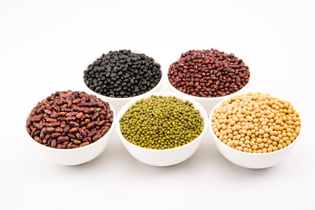 red gram: Close up to various type of beans in a white bowl Stock Photo