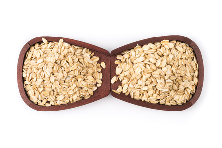 rolled: Rolled oats background. Closeup.