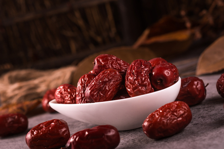 jujube fruits: Dried jujube fruit on wooden table