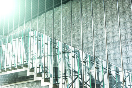 view of a staircase in a shop: Modern office building stairway glass with windows