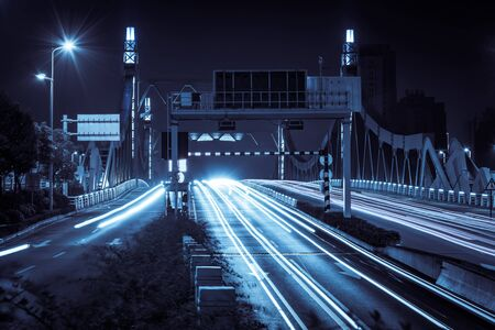 light traces: highway bridge at night with traces of light traffic