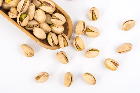 Pistachio nuts. Isolated on a white background. Imagens