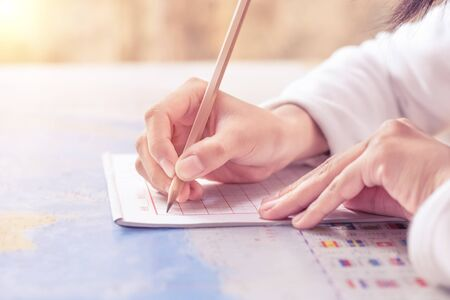 Hand writing on a notebook Stockfoto