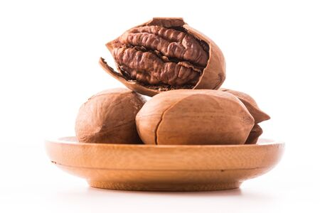 hickory nuts: Pecan nuts with leaves close up on white background Stock Photo