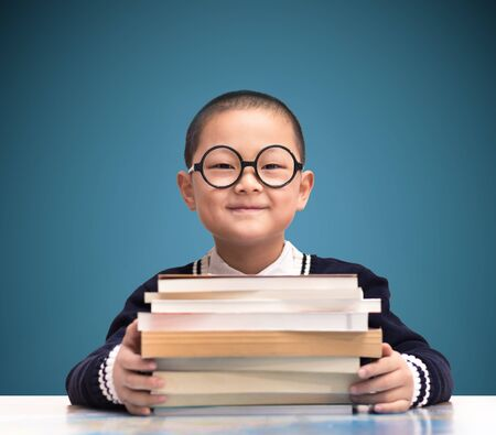 student studying: one boy hold the book