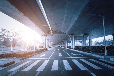flyover: Highway Junction Flyover Ramps New Highway road junction inter section flyover ramps structures complete for vehicle traffic flow. Stock Photo