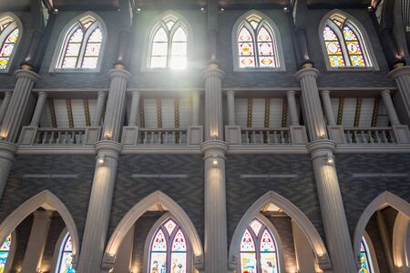 stained glass windows: Arched columns in monastery chapel with stained glass windows