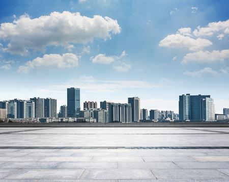 Empty floor with modern skyline and buildings Фото со стока