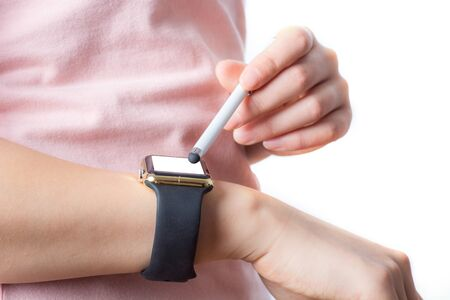 female hands with white smartwatch