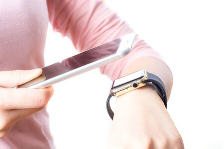 woman using smart watch and smart phone (focus on phone). App template Stock Photo