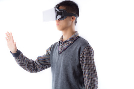 visualizing: Excited man experiencing virtual reality via VR headset and touching something with his hands isolated on white background Stock Photo
