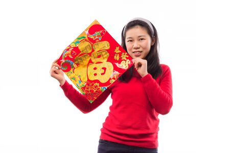 young asian woman holding a red chinese character fu (fu meaning blessing and happiness) wishing happy chinese new year