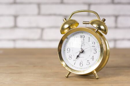 golden alarm clock isolated